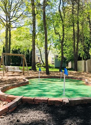 Hyannis Cape Cod vacation rental - Relax! Enjoy the peaceful backyard and new 3 hole putting green.