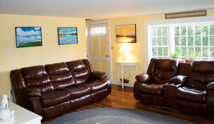 Hyannis Cape Cod vacation rental - Large bright living room with comfy reclining leather furniture