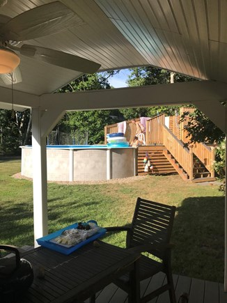 West Yarmouth Cape Cod vacation rental - View from the outdoor covered porch in back yard.