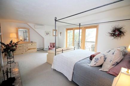 Wellfleet Cape Cod vacation rental - Second floor master with queen, A/C, en-suite bath and deck