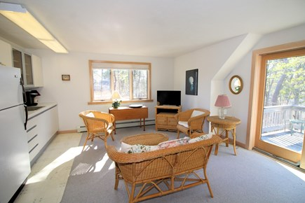 Wellfleet Cape Cod vacation rental - Apartment living room/kitchenette with TV and slider to deck