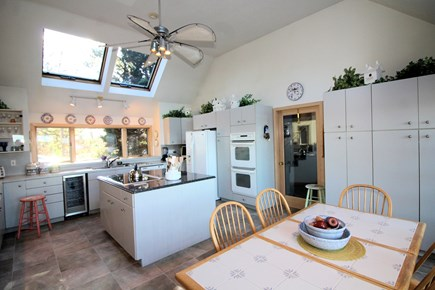 Wellfleet Cape Cod vacation rental - Well-equipped eat-in kitchen with island and French doors to deck