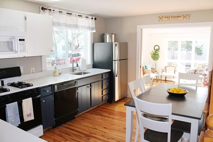 West Yarmouth Cape Cod vacation rental - Kitchen opens to sunroom and table seats 6