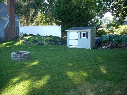 harwich Cape Cod vacation rental - Back yard with firepit