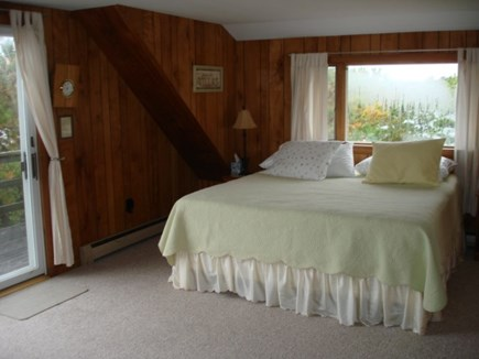 Wellfleet Cape Cod vacation rental - Main bedroom with a private deck and views of water.