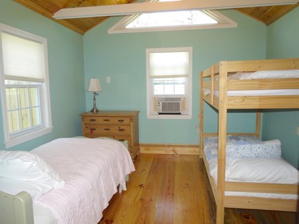 Brewster Cape Cod vacation rental - Bunk cottage bedroom with bunks and a third single bed.