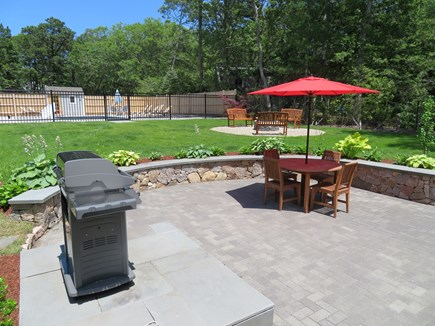 Brewster Cape Cod vacation rental - From patio looking out toward the pool and fire pit.