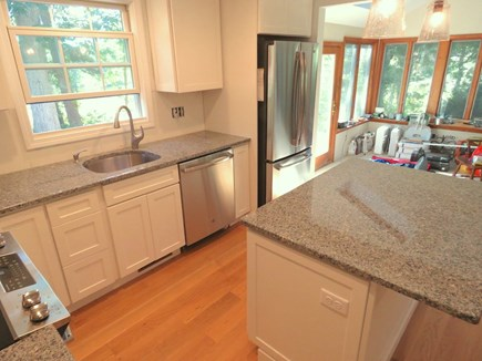 Brewster Cape Cod vacation rental - Looking from kitchen to sun room and door out to patio