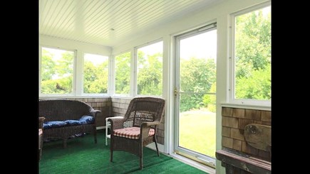 Brewster Cape Cod vacation rental - Screened porch provides welcome outdoor living space.