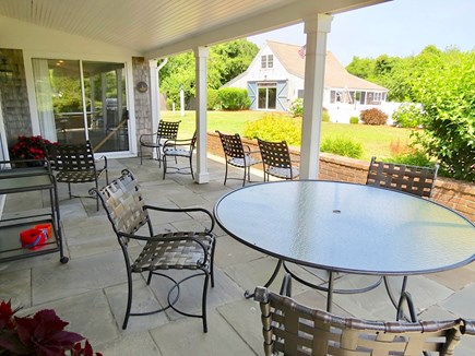 Chatham Cape Cod vacation rental - Patio with plenty of seating has view of pool house.