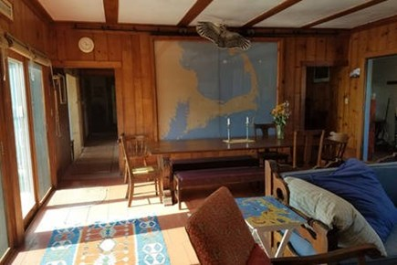 Wellfleet Cape Cod vacation rental - Livingroom with flat screen TV, games, fireplace and Table for 15