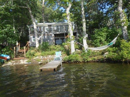 Plymouth, Cedarville MA vacation rental - Back of the house from the water, with hammock at lower right