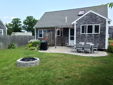 Sandwich Cape Cod vacation rental - Back yard with stone patio, gas grill and fire-pit.