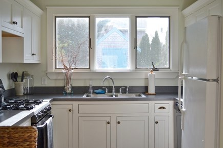 Sandwich Cape Cod vacation rental - Kitchen with gas stove, dishwasher, microwave.