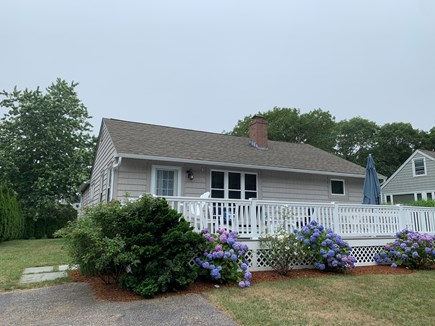 Mashpee, Popponesset Cape Cod vacation rental - Large front porch. Lounge seating & picnic table with umbrella
