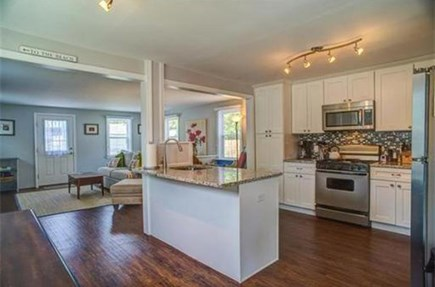 Mashpee, Popponesset Cape Cod vacation rental - Kitchen open to family room, granite counters, Keurig machine