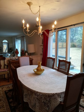 Dennis Cape Cod vacation rental - Dining room looking into the living room &huge window to backyard