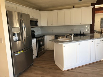 Truro Cape Cod vacation rental - New kitchen with attractive cabinets
