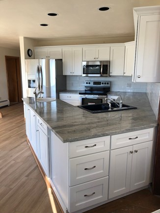 Truro Cape Cod vacation rental - New kitchen features stainless appliances, marble counters
