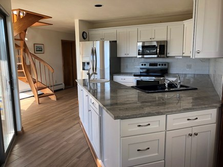 Truro Cape Cod vacation rental - Another view of the kitchen, glass doors open to the large deck