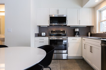 Provincetown Cape Cod vacation rental - Modern eat-in kitchen with stainless steel appliances and dining