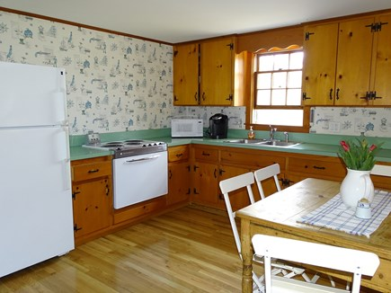 Eastham Cape Cod vacation rental - Kitchen with seating area and new floors!