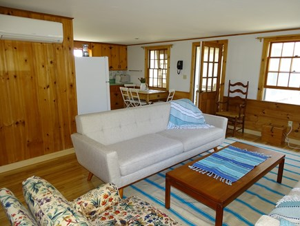Eastham Cape Cod vacation rental - Living room looking towards kitchen, porch