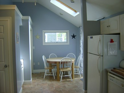 Hyannis-West Hyannis Port Cape Cod vacation rental - Kitchen into dining area. Washer and Dryer inside closet.