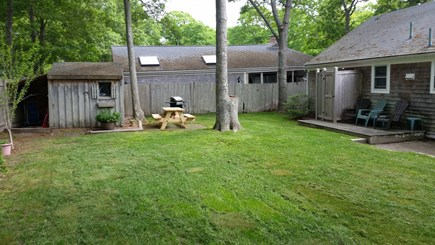 Hyannis-West Hyannis Port Cape Cod vacation rental - Back yard showing outdoor shower, grill