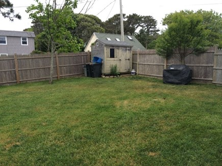 Dennis Port Cape Cod vacation rental - Fenced back yard with grill