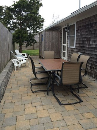 Dennis Port Cape Cod vacation rental - Stone patio with table and seating for 6