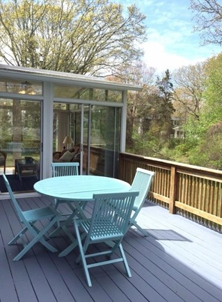 West Falmouth/Old Silver Beach Cape Cod vacation rental - Enjoy a meal outside on the back deck.