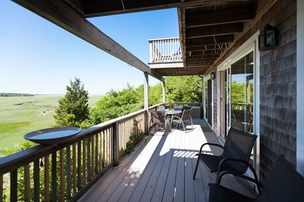 Eastham Cape Cod vacation rental - Large covered deck off main level with views and outdoor seating