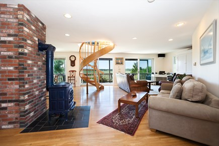 Eastham Cape Cod vacation rental - Spacious living area with spiral staircase and access to deck