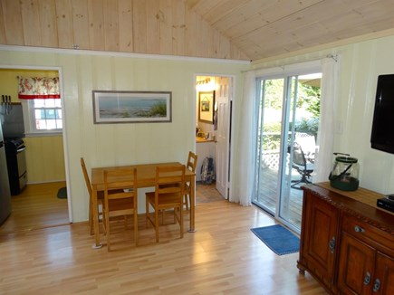 South Yarmouth Cape Cod vacation rental - Living  / dining room combo that opens up to the deck