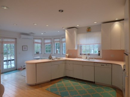 Dennis Cape Cod vacation rental - Retro Kitchen with eating area and door to the side patio.