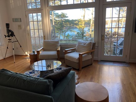 Brewster Cape Cod vacation rental - Living room with large windows and doors for amazing pond views