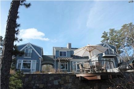 Brewster Cape Cod vacation rental - View of guest house (left of breezeway) and cantilevered table