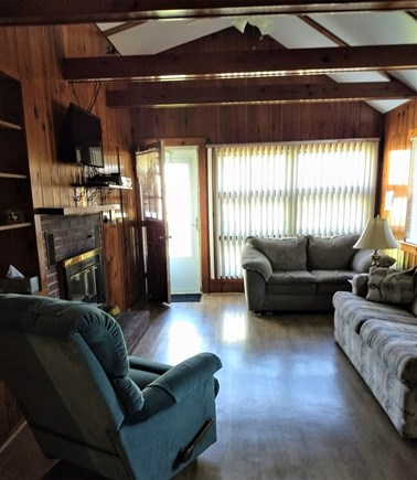 Truro Cape Cod vacation rental - Comfortable living area with a full sized sofa bed, ceiling fan.