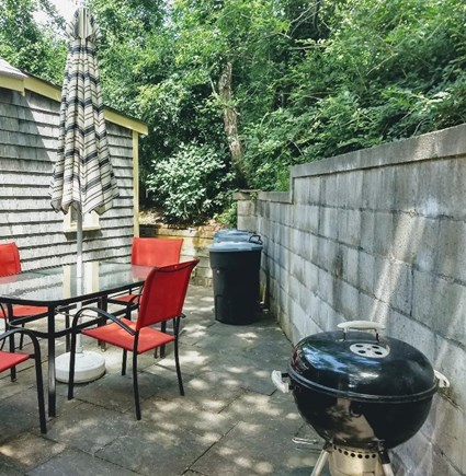 Truro Cape Cod vacation rental - Large back patio with a bar-b-que grill to make lunch or dinner.