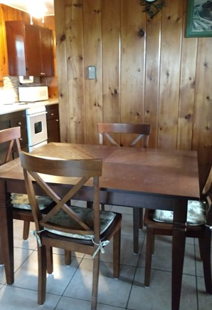 Truro Cape Cod vacation rental - Cottage dining area seats four and has extra chairs available.