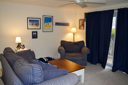 Provincetown Cape Cod vacation rental - Living room, facing porch.  Carpeted, open to kitchen.