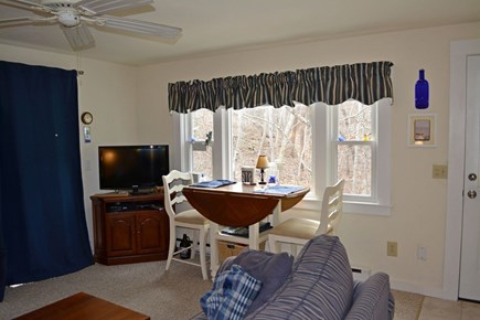 Provincetown Cape Cod vacation rental - Dining area with view of hill, shrubs and trees bordering unit.