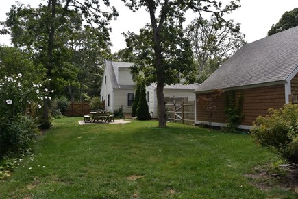 Brewster Cape Cod vacation rental - Waterfall House: large, private back yard & outdoor dining table.