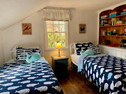 Harwich Cape Cod vacation rental - Whale Room with 2 twin beds and bookcase full of books and games