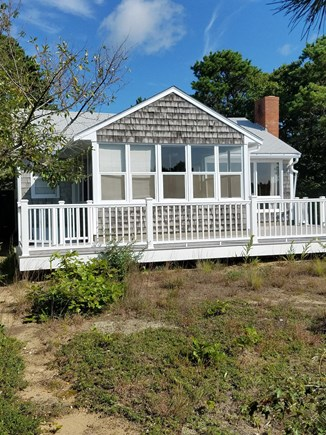 Eastham, Bayside Cape Cod vacation rental - Back of cottage with wrap around deck.