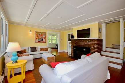 Wellfleet Cape Cod vacation rental - Cheery and bright living room with gas fireplace