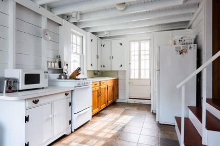 Wellfleet Cape Cod vacation rental - Cottage kitchen with stacked washer and dryer
