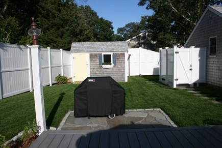 West Harwich Cape Cod vacation rental - Grilling area, shed & outdoor shower with changing area