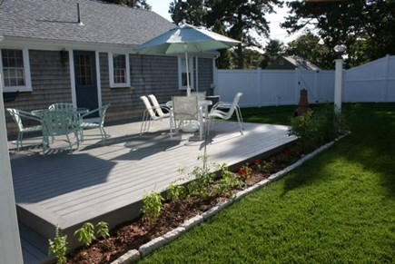 West Harwich Cape Cod vacation rental - 2 patio tables with seating for 10 plus market umbrella